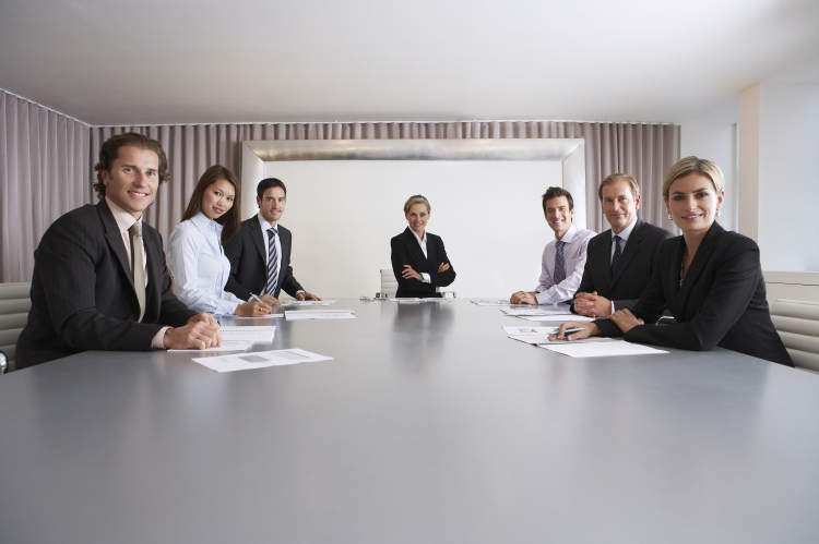Portrait of multiethnic business people with paperwork in meeting room_shutterstock.jpg