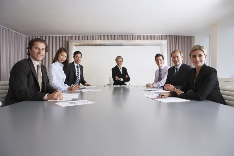 Portrait of multiethnic business people with paperwork in meeting room_shutterstock.jpg