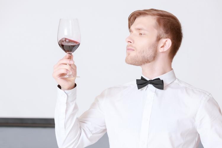 sommelier examining wine_shutterstock